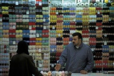 vendor showing yarn at counter