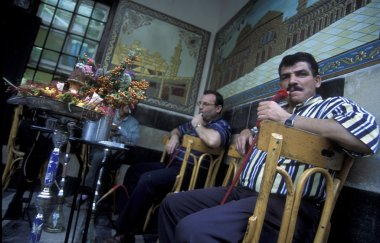 customers smoking hookahs in cafe in Aleppo