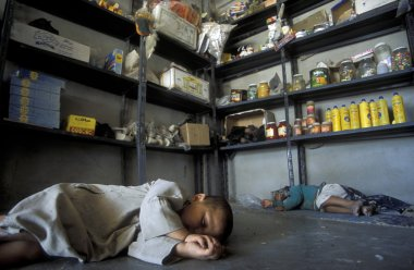 children sleeping on floor of convenience store