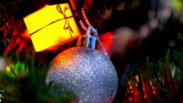 Christmas and New Year Decoration. Bauble Hanging on Christmas Tree.