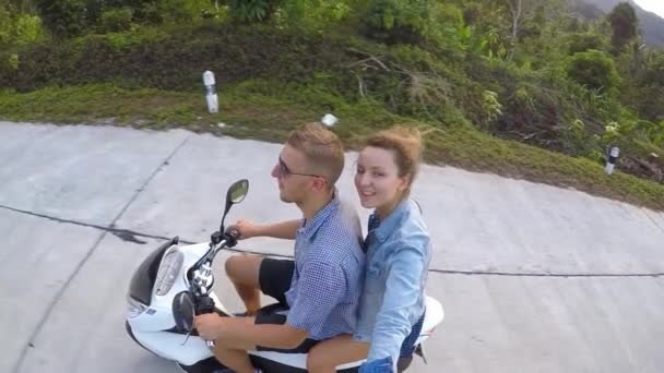 Happy Young Fashion Couple on Scooter Enjoying Road Trip