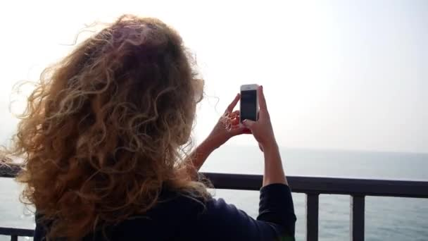 Woman Taking Pictures of Sea with Smartphone. Slow Motion.