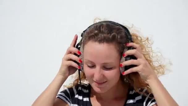 Young Beautiful Woman in Bright Sun Enjoying Music in Headphones.