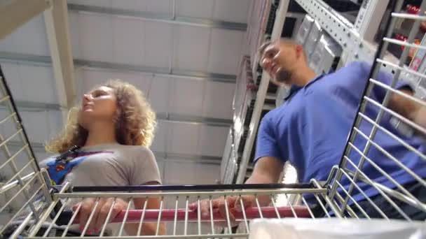 Happy Couple with Shopping Cart in Supermarket
