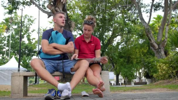 Tourists Resting after Sightseeing City with Map