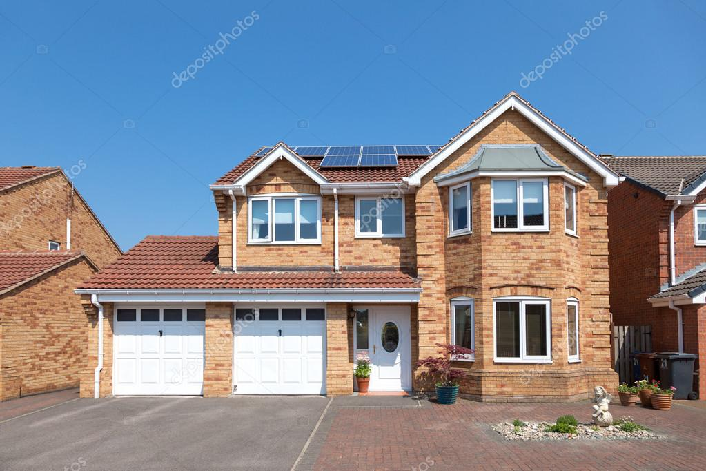 Modern English House With Double Garage Stock Photo