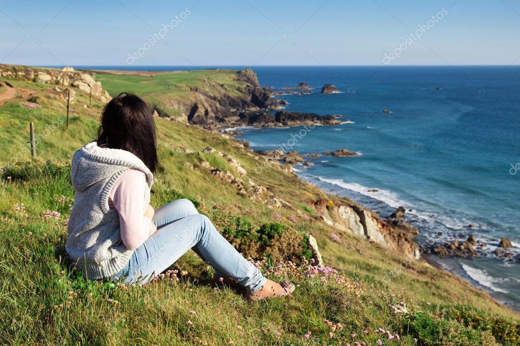 Woman looking out to sea side view