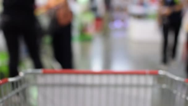 Blurred of Shopping cart in supermarket