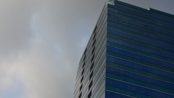 Glass building with blue sky, Timelapse