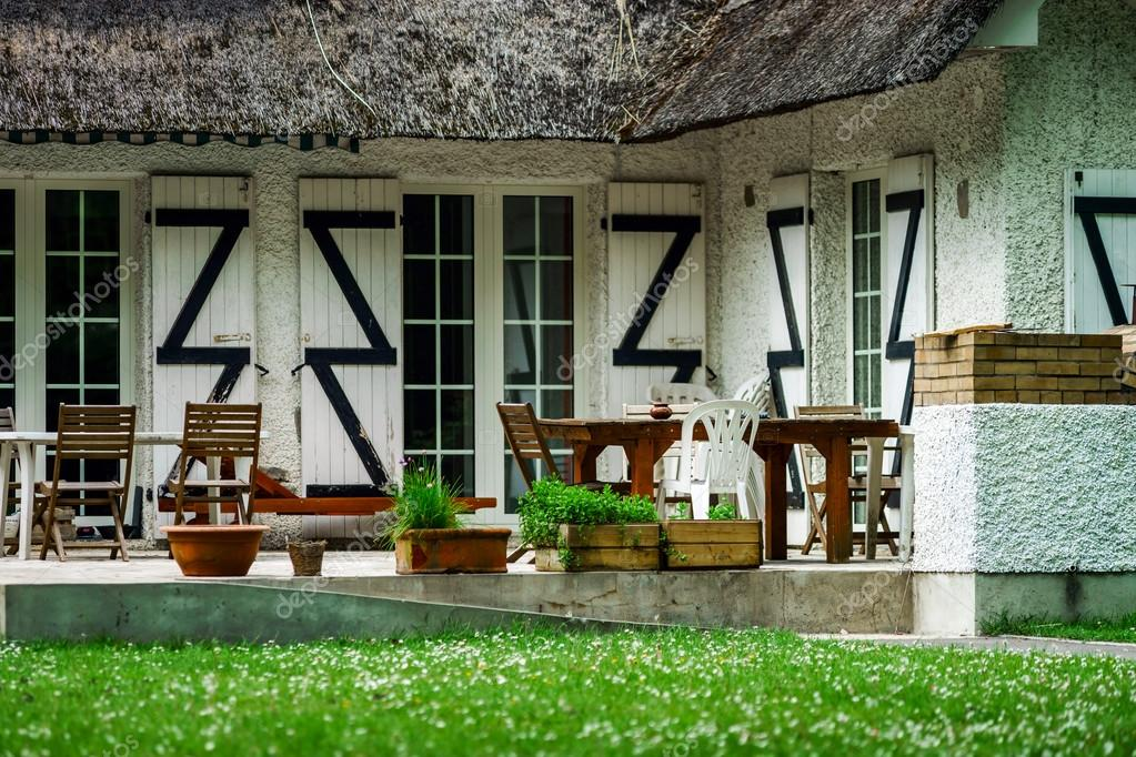 Typical French Countryside House With Thatch Roof Stock Photo