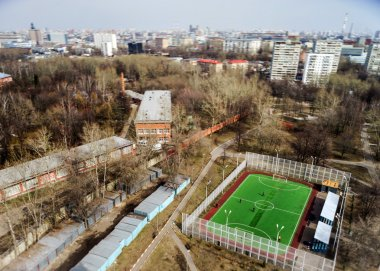 Moscow aerial tilt-shift panorama, small football stadium