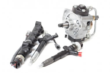 new solenoid injectors for diesel fuel lying on a white background with a rod and a fuel injection pump