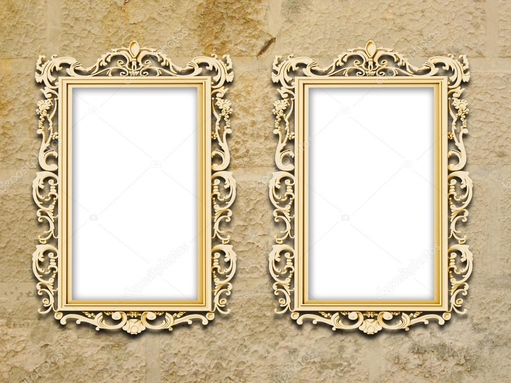 Two golden baroque frames on grungy yellow concrete wall — Stock ...