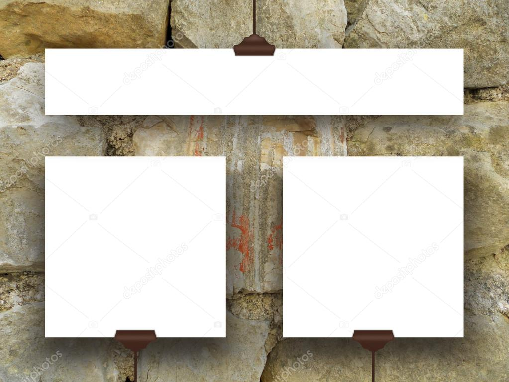 Three hanged square and rectangular frames on ancient stone wall ...