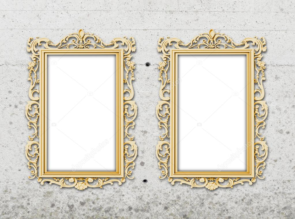 Two golden baroque frames on grey concrete wall — Stock Photo ...