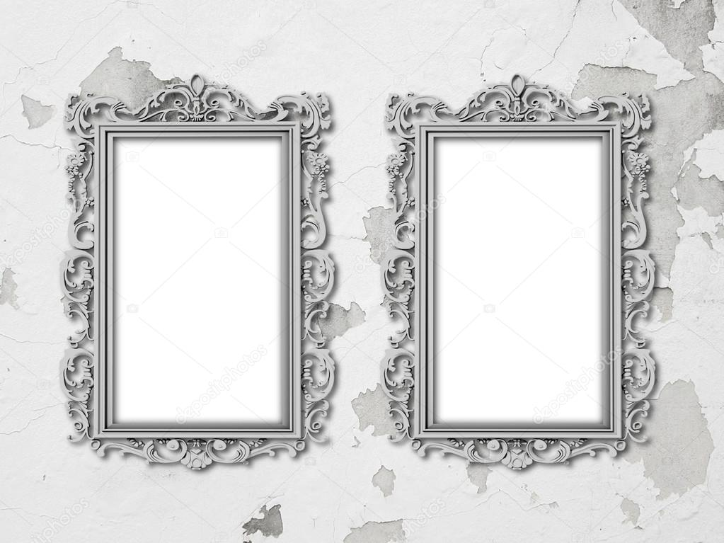 Two silver baroque frames on grey scratched and cracked concrete ...