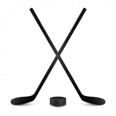Two crossed hockey sticks and puck. Isolated on white