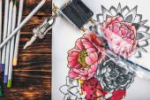 beautiful sketch drawing with colored pencils lying on old wooden background