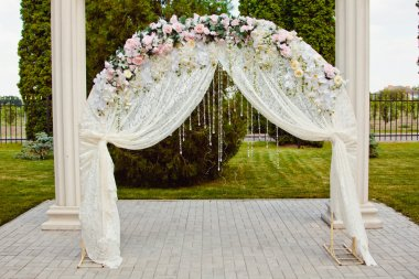 beautiful path to wedding ceremony marquee with flowers