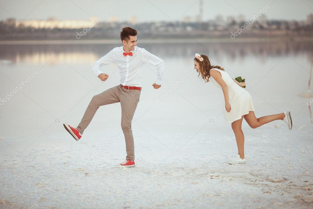 Young couple enjoying on the beach