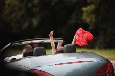 Freedom - happy free couple in car driving