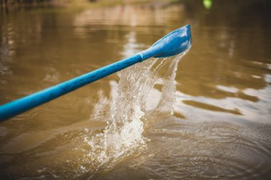 Blue paddle on river water
