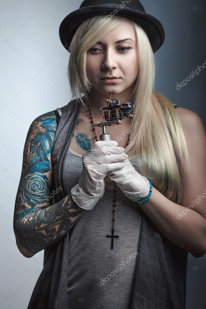 Beautiful girl tattoo artist with tattoos stock photo for Girl tattoo artist
