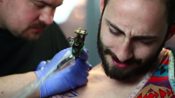 Tattooist makes a tattoo
