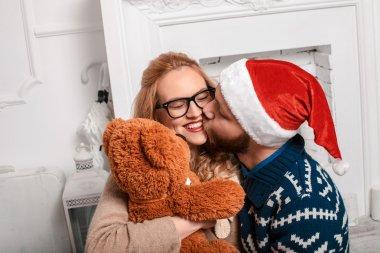 Beautiful couple in Santa hat