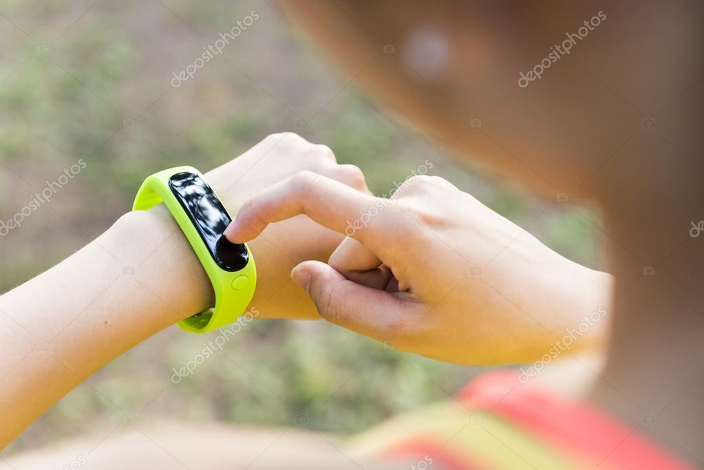 Female sport fitness runner getting ready for jogging outdoors