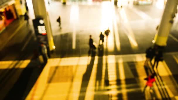 People walking in city night background. Pedestrians walking in city night with lights. Out of focus background from busy big city with people crossing street