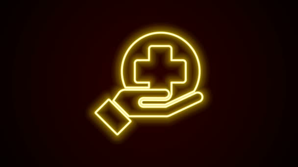 Glowing neon line Cross hospital medical icon isolated on black background. First aid. Diagnostics symbol. Medicine and pharmacy sign. 4K Video motion graphic animation