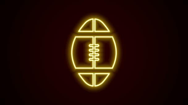 Ragyogó neon vonal rögbi labda ikon elszigetelt fekete háttérrel. 4K Videó mozgás grafikus animáció