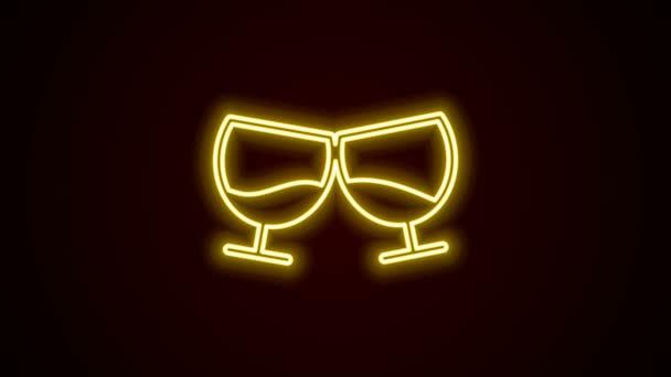 Ragyogó neon vonal Üveg konyak vagy brandy ikon elszigetelt fekete alapon. 4K Videó mozgás grafikus animáció