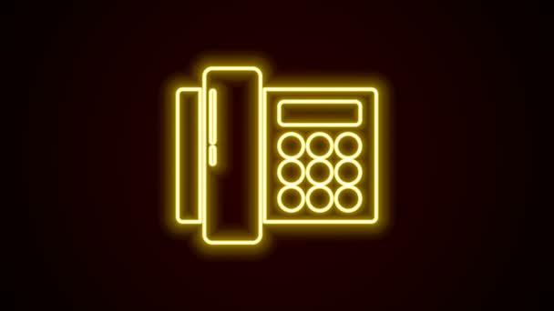 Žhnoucí neonová linka Ikona telefonu izolovaná na černém pozadí. Telefon pevnou linkou. Grafická animace pohybu videa 4K