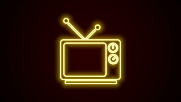 Zářící neonová linka Retro TV ikona izolované na černém pozadí. Televizní značka. Grafická animace pohybu videa 4K