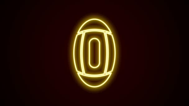 Leuchtende Leuchtschrift American Football Ball Ikone isoliert auf schwarzem Hintergrund. Rugby-Ball-Ikone. Mannschaftssportspiel-Symbol. 4K Video Motion Grafik Animation