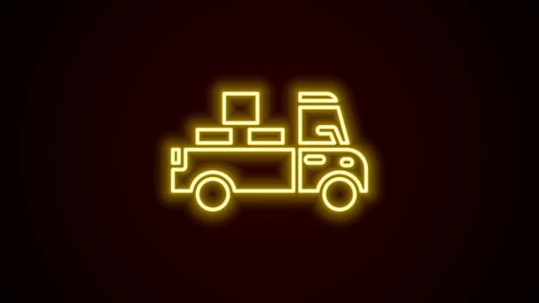 Leuchtende Leuchtschrift Lieferwagen mit Pappkartons hinter Symbol isoliert auf schwarzem Hintergrund. 4K Video Motion Grafik Animation