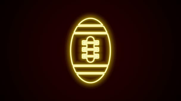 Ragyogó neon vonal Amerikai futball ikon elszigetelt fekete háttérrel. Rögbi labda ikon. Csapat sport játék szimbólum. 4K Videó mozgás grafikus animáció