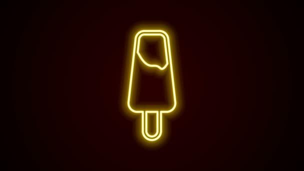 Zářící neonová linie nanuková zmrzlina na dřevěné tyčce ikona izolované na černém pozadí. Grafická animace pohybu videa 4K