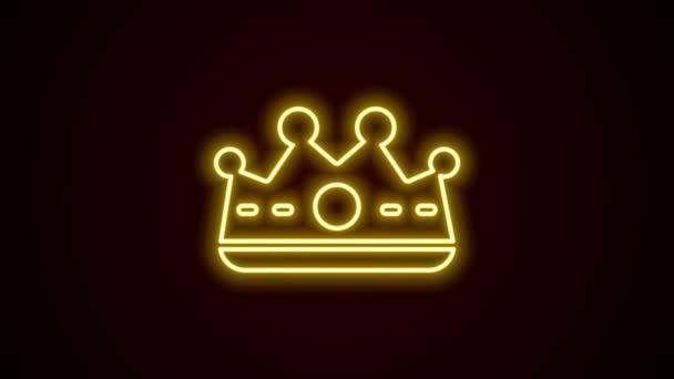 Ragyogó neon vonal King korona ikon elszigetelt fekete háttérrel. 4K Videó mozgás grafikus animáció