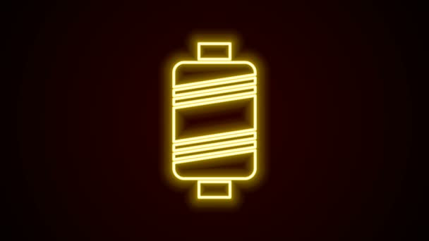 Glowing neon line Sewing thread on spool icon isolated on black background. Yarn spool. Thread bobbin. 4K Video motion graphic animation