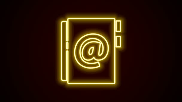 Glowing neon line Address book icon isolated on black background. Notebook, address, contact, directory, phone, telephone book icon. 4K Video motion graphic animation