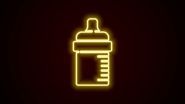 Glowing neon line Baby bottle icon isolated on black background. Feeding bottle icon. Milk bottle sign. 4K Video motion graphic animation
