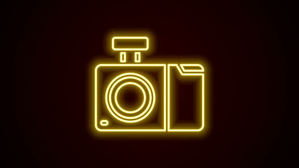Glowing neon line Photo camera icon isolated on black background. Foto camera icon. 4K Video motion graphic animation