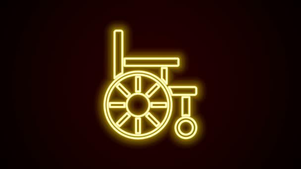 Leuchtende Neon-Linie Rollstuhl für Behinderte Symbol isoliert auf schwarzem Hintergrund. 4K Video Motion Grafik Animation