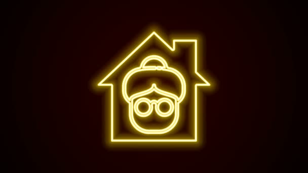 Glowing neon line Nursing home building icon isolated on black background. Health care for old and sick people. Center for retired people. 4K Video motion graphic animation