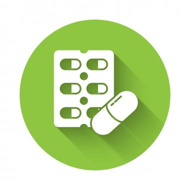 White Pills in blister pack icon isolated with long shadow. Medical drug package for tablet, vitamin, antibiotic, aspirin. Green circle button. Vector Illustration. icon