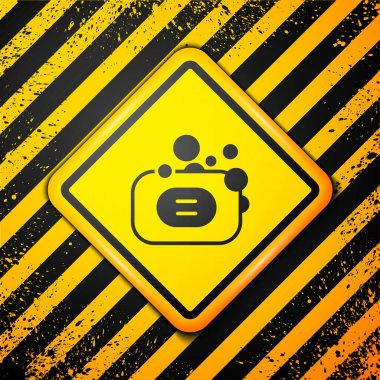 Black Bar of soap icon isolated on yellow background. Soap bar with bubbles. Warning sign. Vector. icon
