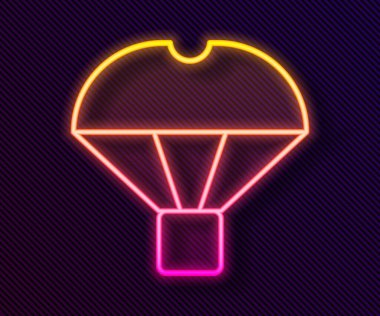 Glowing neon line Box flying on parachute icon isolated on black background. Parcel with parachute for shipping. Delivery service, air shipping.  Vector. icon